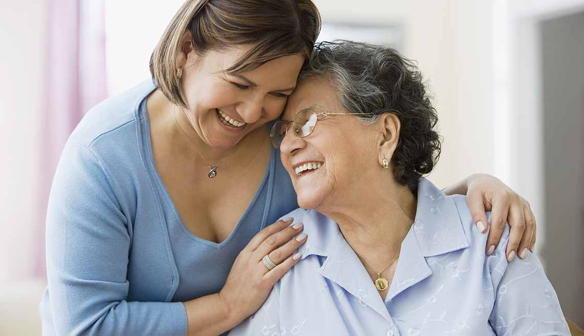 two women hugging, caregiving in colorado 2020