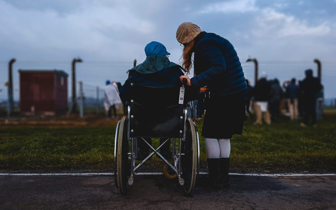 caregiver helping person in a wheelchair