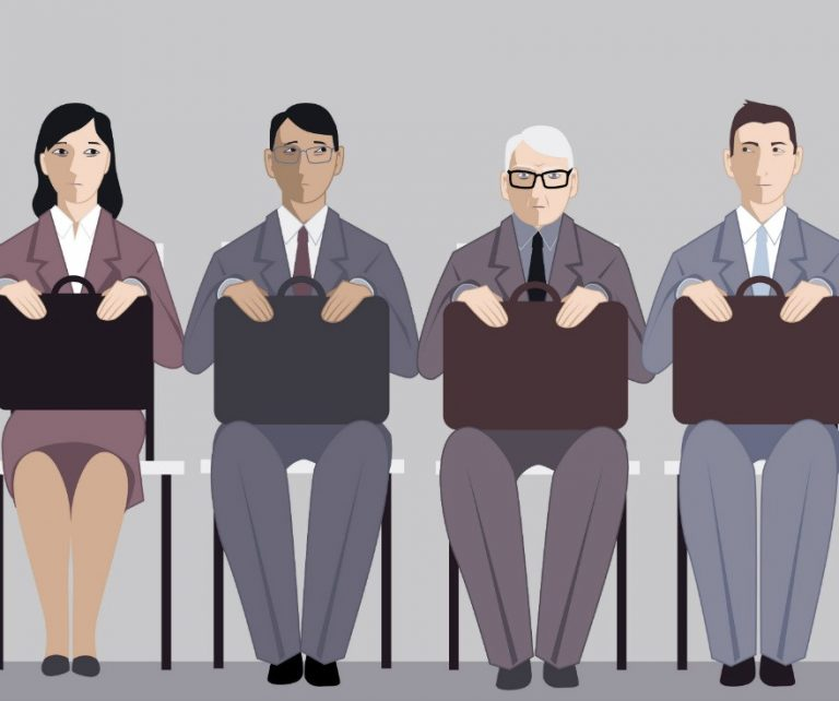 cartoon illustration with four people holding briefcases (age discrimination in colorado)